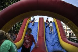 Children play in the inflatable slides during the RiverFest in downtown Riverside on July 22.   William Camargo/Staff Photographer