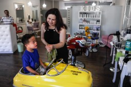 Let Hair Go co-owner Ana Velazquez puts the finishing touches on a haircut for Evan Yogya at the new downtown Riverside salon on July 28. Velazquez and her husband, Miguel Salcedo, want the business to appeal to the entire family, from mom and dad to their little ones. | William Camargo/Staff Photographer
