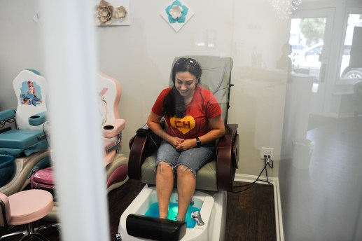 Elvira Torres gets ready for a pedicure that is offered at Let Hair Go Salon on July 28. | William Camargo/Staff Photographer