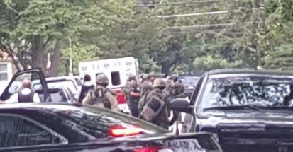 SWAT officers gather on 8th Avenue in North Riverside on Aug. 6 in response to a report of an armed man who sexually assaulted his girlfriend inside her home. (Photo provided)