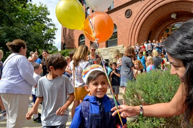 Ethan Avila, 7, of Riverside, wears a birthday hat, after the first day of school on Aug. 24, outside of Central Elementary in Riverside. The Central School bell tower built in 1897, rang its bell at dismissal for the first time in a decade, following recent repairs. | Alexa Rogals/Staff Photographer