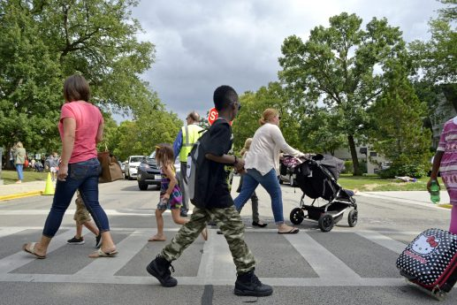 Students and parents walk across the road on Thursday, Aug. 24, outside of Central Elementary School in Riverside. | Alexa Rogals/Staff Photographer