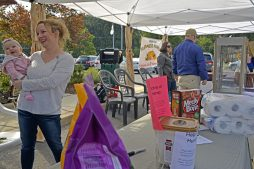 Megan Shilney, of Brookfield, collects donations with her daughter, Eleanor on Sept. 2, for Hurricane Harvey victims during the Brookfield farmers market at Village Hall in Brookfield. | Alexa Rogals/Staff Photographer
