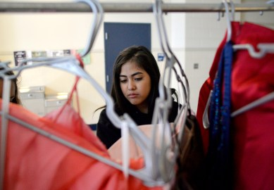 Junior Denise Navarro, of Riverside, looks at dresses displayed on Saturday, Sept. 9, during the RBHS PTO's Fall Flash Boutique at the high school. | Alexa Rogals/Staff Photographer