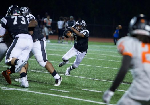 Fenwick senior running back Jason Ivery rushed for 164 yards and two touchdowns on 23 carries during the Friars' 28-0 win against visiting Leo. (Photo by Ian McLeod)