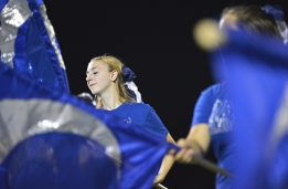 Members of the RBHS Color Guard perform with the marching band during Riverside-Brookfield High School's Homecoming halftime show on on Sept. 22. | Photos by Alexa Rogals/Staff Photographer