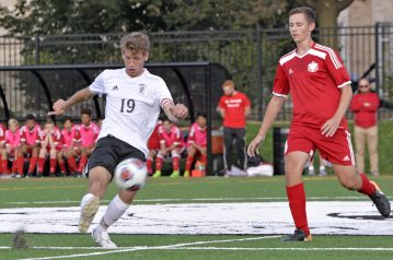 Fenwick's Mariano Mollo (19) passes the ball on Friday, Sept. 29, 2017, during a soccer game against St. Joseph at Priory Park in River Forest, Ill. (Alexa Rogals/Staff Photographer)