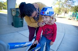 Patricia Kulikauskas, of Brookfield, helps her son Noah, 4, put his helmet on before riding his bike on Monday, Oct. 16, after school at Kiwanis Park in Brookfield.   Alexa Rogals/Staff Photographer