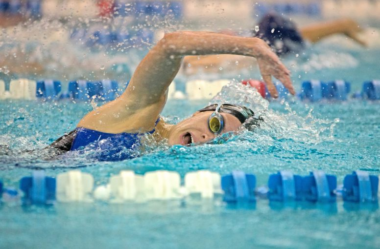 RBHS varsity swimmer Shea Connelly competes in the 100-yard freestyle on Thursday, Oct. 12, 2017, during a girls swim meet against Chicago Latin at Riverside-Brookfield High School. (Alexa Rogals/Staff Photographer)