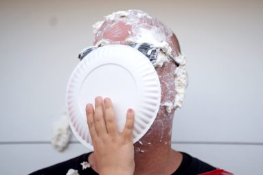 A student pies principal Peter Gatz on Oct. 20, at Central Elementary School in Riverside. | Alexa Rogals/Staff Photographer