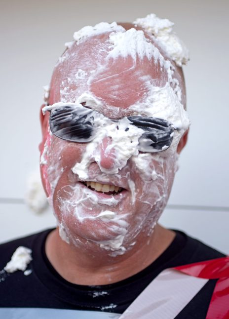 Principal Peter Gatz laughs after getting pied in the face on Friday, Oct. 20, at Central Elementary School in Riverside