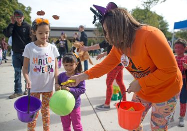 Volunteers hand out candy to children on Oct. 21, during the Boo at the Zoo event at Brookfield Zoo. | Alexa Rogals/Staff Photographer