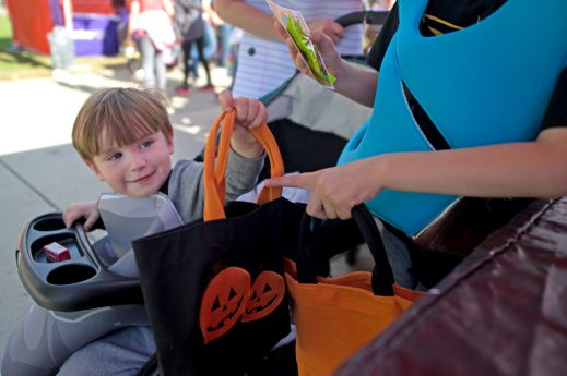 Children go up to different booths and receive treats and candy from volunteers | Alexa Rogals/Staff Photographer