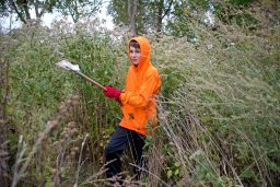 Chancellor Rayfield, 12, picks up trash in the forest preserve area along the south banks of the Des Plaines River during the 42nd Annual Hofmann Dam River Rats Fall Clean-up on Oct. 21. | Alexa Rogals/Staff Photographer