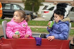 Children drink juice boxes that were handed out by the village on Oct. 28, during the Monsters on Main Street costume contest at Grossdale Station in Brookfield, Ill. The village also handed out free taffy apples and pumpkins. | Alexa Rogals/Staff Photographer