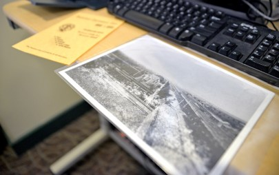 The library seeks volunteers to help with the massive effort, which includes hundreds of historic photos.   Alexa Rogals/Staff Photographer