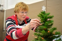 Marilynn Long, of Buffalo Grove, decorates a small tree at her booth on Nov. 4, during the annual Holiday Bazaar at the Village Commons on Des Plaines Avenue in North Riverside. | Alexa Rogals/Staff Photographer