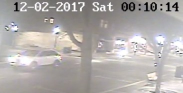 Police have released still photos from surveillance videos in downtown Riverside of the white SUV suspected of being involved in a drive-by shooting in the 200 block of East Burlington Street on Dec. 1.