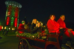 Attendees take ride in horse drawn carriage through the downtown business district on Dec. 1, during the annual Riverside Chamber of Commerce Holiday Stroll. | ALEXA ROGALS/Staff Photographer