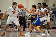LTHS junior guard Josh Berry (10) passes the ball on Friday, Dec. 8, 2017, during a varsity basketball game against OPRF in the Fieldhouse at Oak Park and River Forest High School. | ALEXA ROGALS/Staff Photographer