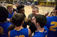 LT's head coach Tom Sloan, middle, talks with the team during a time out on Friday, Dec. 8, 2017, during a varsity basketball game against OPRF in the field house at Oak Park and River Forest High School. | ALEXA ROGALS/Staff Photographer