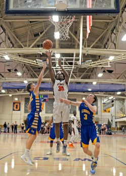 OPRF's Anthony Roberts (30) shoots a lay up shot on Friday, Dec. 8, 2017, during a varsity basketball game against Lyons Township in the field house at Oak Park and River Forest High School. | ALEXA ROGALS/Staff Photographer