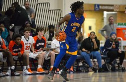 LT's Tyrese Shines (2) dribbles the ball and looks to pass to an open player on Friday, Dec. 8, 2017, during a varsity basketball game against OPRF in the field house at Oak Park and River Forest High School. | ALEXA ROGALS/Staff Photographer