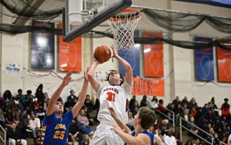 OPRF's Charlie Hoehne (31) shoots a lay up on Friday, Dec. 8, 2017, during a varsity basketball game against Lyons Township in the field house at Oak Park and River Forest High School. | ALEXA ROGALS/Staff Photographer