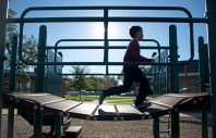 Michael Kulikauskas, 7, of Brookfield, runs through the jungle gym after school at the Kiwanis Park playground on Oct. 16. | Alexa Rogals/Staff Photographer
