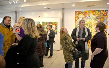 Attendees mingle and look through the art on Jan. 5, during the opening night and first exhibition at Compassion Factory Art Gallery. | Alexa Rogals/Staff Photographer