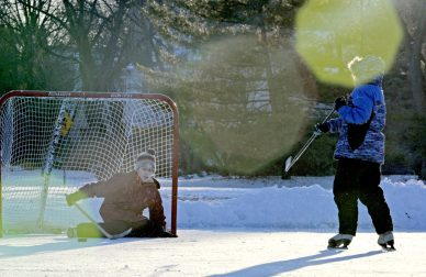 On Jan. 18, the deep freeze of the prior two weeks gave way to fine skating weather before the mercury blew through 50 degrees over the weekend and initiated a general thaw. Families took advantage of the short weather window to play hockey and take a few turns around the ice rink at Big Ball Park in Riverside. | Alexa Rogals/Staff Photographer