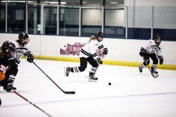 Fenwick senior defensemen Megan Krikau controls the puck with teammates Erin Proctor on her left and Emily Franciszkowicz on her right. (Submitted photo)