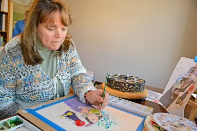 Heather Kadlec's career as an educator came to a sudden end after a stroke in 2011. After years of therapy, she has turned to art - painting water colors that she now sells at area stores. | Alexa Rogals/Staff Photographer