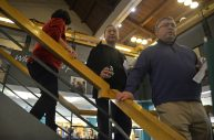 Attendees take their wine down to the lower level on Feb. 3 during the Between The Wines fundraiser event at Riverside Public Library. | Alexa Rogals/Staff Photographer