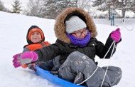 A foot of snow over the weekend brought a crowd of kids to the sledding hill in Village Commons Park in North Riverside on Feb. 10. | Alexa Rogals/Staff Photographer