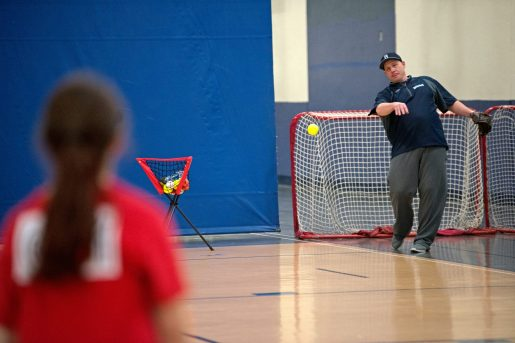 Dave Campbell, right, tosses the ball to a player on Feb. 17, 2018, during assessments in the field house at Riverside Brookfield High School. | Alexa Rogals/Staff Photographer