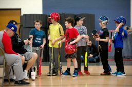 Children trying out for the minor division line up on Feb. 17, during assessments in the field house at Riverside Brookfield High School. | Alexa Rogals/Staff Photographer