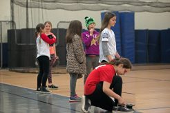Attendees trying out for softball line up on Feb. 17, during assessments in the field house at Riverside Brookfield High School. | Alexa Rogals/Staff Photographer