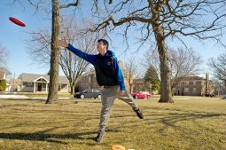 John Fletcher, a freshman at Riverside-Brookfield High School plays disc golf with his family on Sunday, March 4 in Kiwanis Park in Brookfield. | Alexa Rogals/Staff Photographer
