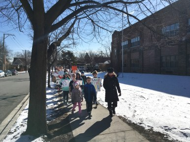 Principal Claudia Jimenez leads students in a march around Congress Park School in Brookfield during a walkout protesting school gun violence on March 14. (Photo by Bob Skolnik | Contributor)