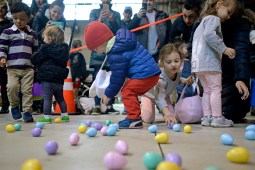 Children quickly pick up Easter eggs on March 24, inside the Riverside Public Works facility in Riverside Lawn for the village's annual Easter Egg Hunt. | Alexa Rogals/Staff photographer