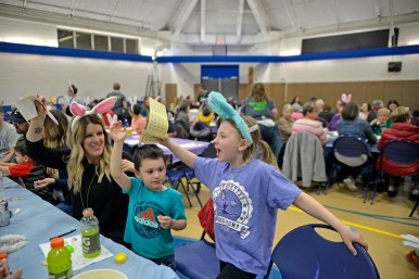 Winners hold up their bingo cards on March 23, during Bunny Bingo at the Village Commons in North Riverside. | Alexa Rogals/Staff photographer
