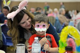 Mary Kennedy, left, and her son Cameron, 3, play with a bunny mask on March 23, during Bunny Bingo at the Village Commons in North Riverside. | Alexa Rogals/Staff photographer