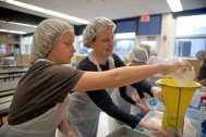 Volunteers measure out the noodles for each bag during a Feed Our Community event on April 14 in conjunction with the Hauser Junior High School food drive, sponsored annually by the school's PTO. | Alexa Rogals/Staff Photographer