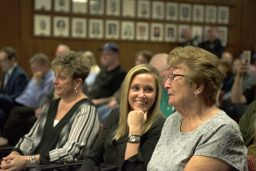 The family of Mark Duffek, incoming fire chief, tear up as he gives his speech on April 23, during a Village Board meeting at Brookfield Village Hall. | Alexa Rogals/Staff Photographer
