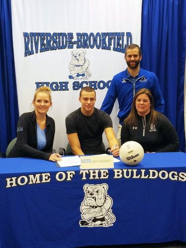(Left to right) St. Ambrose University head volleyball coach Dawn Kerr, RBHS senior Jason Bageanis. RBHS assistant volleyball coach Jen Lyon and RBHS head volleyball coach Dan Bonarigo at Bageanis' signing day. (Courtesy Jim Bageanis)