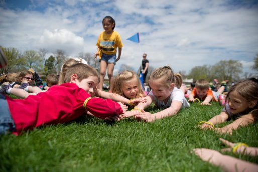 First-graders from Brook Park School take an exercise break on the soccer field at Yena Park in LaGrange Park during a walkathon held to raise funds for a new playground at the school, which will undergo a major construction project over the next year-plus. | Alexa Rogals/Staff Photographer