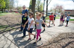 Brook Park School first-graders take laps around Yena Park in LaGrange Park during their turn outside for a walkathon, one of several events planned by the Brook Park Council to raise funds for a new playground at the soon-to-be expanded school. | Alexa Rogals/Staff Photographer
