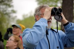 Members of the group look out for birds during a guided tour on World Migratory Bird day, May 12, along the river in Riverside. | Alexa Rogals/Staff Photographer