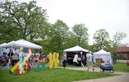 Attendees enter the artist booth area on May 19, during the annual Riverside Arts Weekend, at Guthrie Park in Riverside. | Alexa Rogals/Staff Photographer